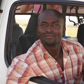 Van driver  by Cyndi Rosenthal - People Portraits of Men ( van driver africa safari )