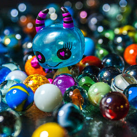 Little horned devil and her eggs by Maurizio Riccio - Artistic Objects Toys ( macro, marbles, toys, artistic objects, close up )