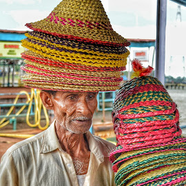 The poor Seller by Uttam Das - People Street & Candids ( hats, face, potrait, candid, sailor,  )