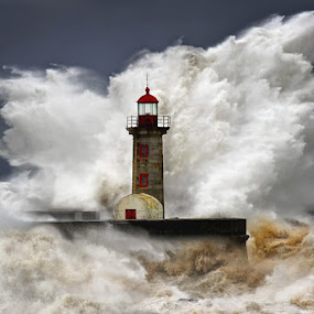 enduring the elements 2 by Malinov Photography - Travel Locations Landmarks ( huge, waves, lighthouse, ocean, storm, dangerous )