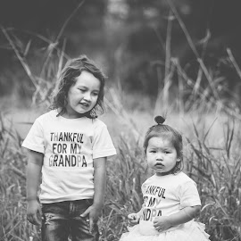 Protector by Jenny Hammer - Babies & Children Children Candids ( sisters, girl, black and white, fall, brother, kids, siblings, cute, boy )