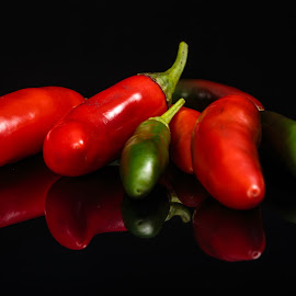 Last Peppers of the Season by Tom Whitney - Food & Drink Fruits & Vegetables ( serrano, refective, shell, reflection, peppers, green, black background, red, food, horizontal, cerrano, hot, eating, reflect, shiny )