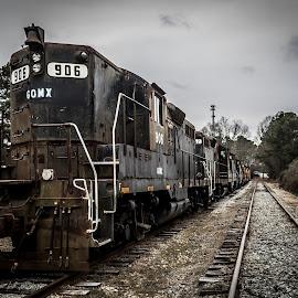 Retired Engines - CSX by Liam Douglas - Transportation Trains ( wooden, csx, railraod, engines, railyard, tracks, steel, trains )