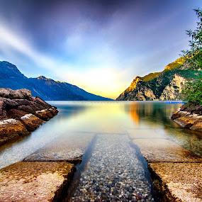 A silent sunrise. by Mattia Bonavida - Landscapes Waterscapes ( clouds, water, bonavida, garda, colors, lake, landscape, shot, amazing, mountains, sky, mattia, sunrise, nikon, italy )