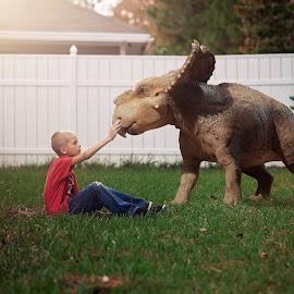 In My Backyard by Chrystal Olivero - Babies & Children Child Portraits ( dinosaur, fun, backyard, imagination, boy, portrait )