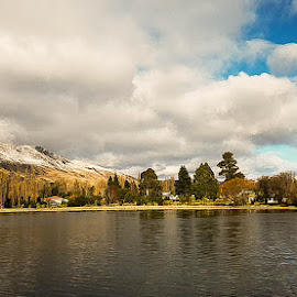 My Town in Winter by Perla Tortosa - Instagram & Mobile Android ( clouds, sky, winter, trees, lake )