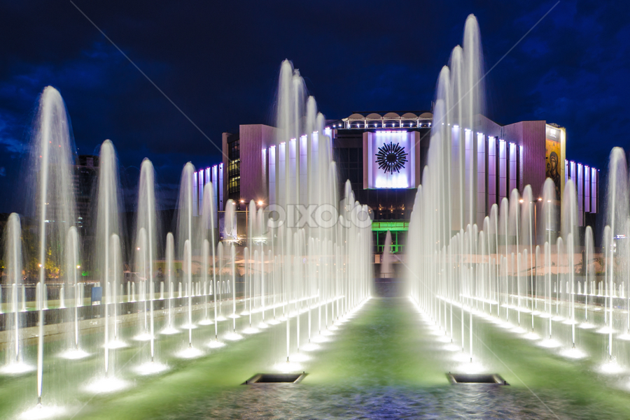 Fountain at National Palace of Culture in Sofia in the night  by Anton Donev - Buildings & Architecture Public & Historical ( famous, npc, architecture, beauty, cityscape, travel, city, lights, sky, pool, milk, no people, bulgaria, clouds, water, building, park, dusk, soft, landmark, fountain, outdoor, sophia, summer, night, fairy-scene, slow shutter, sofia )