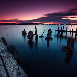 Sunset with Pier and Tire by Dimitar Novkov - Landscapes Sunsets & Sunrises ( sunset, pier, tire )