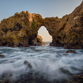 Cliff Jumpin by Givanni Mikel - Landscapes Caves & Formations ( cliff jumping, corona del mar, arch, sunset, california )