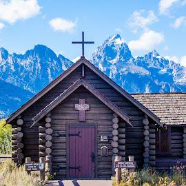 Transfiguration by Jennifer  Loper  - Buildings & Architecture Places of Worship ( blue sky, log cabin, tetons, jackson hole, white clouds, cross, mountain range, chapel, wyoming, trees )