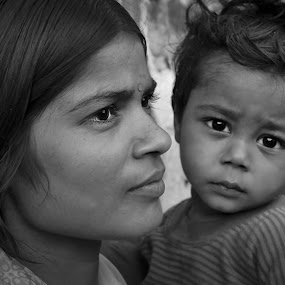 her hope! by Rajarshi Mitra - People Family ( child, slum, monochrome, mother, black and white, poor, india, boy, people, kid )