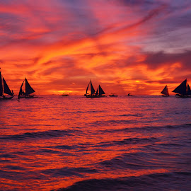 sunset by Philip Familara - Landscapes Sunsets & Sunrises ( orange, boracay, sunsets, sunset, boats, sundown, sail, sailboat, boat, philippines, island )