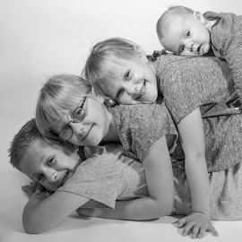 All stacked up by Vix Paine - Babies & Children Child Portraits ( sister, blackandwhite, sisters, stacked, family love, children, laying, baby, brother, siblings, baby boy, brothers )