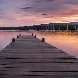 Sunset at Ambleside by Darrell Evans - Buildings & Architecture Bridges & Suspended Structures ( water, countryside, clouds, hills, uk, lake, boat, landscape, lake district, ambleside, mountains, sky, windermere, sunset, outdoor, trees, pier )