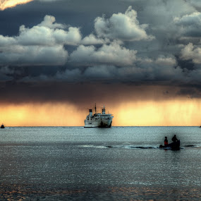 Back to harbour by Girolamo Cavalcante - Landscapes Weather ( clouds, fishermen, sunset, boat, storm,  )