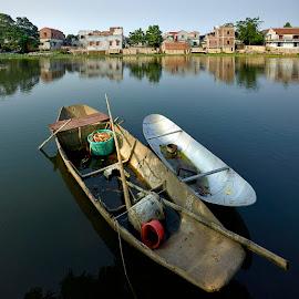 Fishing Boat Tho Ha Village Vietnam  by Fokion Zissiadis - Transportation Boats ( village, vietnam, lake, travel, sunrise, fishing )