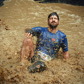 Taking A Bath ! by Marco Bertamé - Sports & Fitness Other Sports ( water, splatter, splah, differdange, 2015, eyes closed, number, soup, luxembourg, muddy, sitting, strong, blue, beard, brown, strongmanrun, man, 1165 )