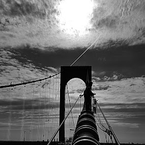 Morning sun through the clouds above BWB by Chris Gray - Black & White Buildings & Architecture ( clouds, traffic, black and white, bridge, sun )