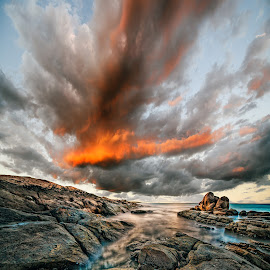 Fire by Greg Tennant - Landscapes Sunsets & Sunrises ( clouds, sunset, rocks )