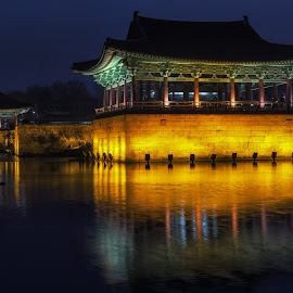 anapji at night by Aaron Choi - Buildings & Architecture Other Exteriors ( night light, famous, pagoda, cultural, reflections, beauty, architecture, travel, landscape, historic, asian, ahnapji, nature, iconic, paalce, vast, historic site, asia, shilla, pond, north gyeongsang province, gyeongsang province, korea, donggung palace, water, gyeongju, wolji pond, peaceful, pavilion, tourism, architectural detail, scenic, donggung palace and wolji pond, seorabeol, destination, gyeongsangbukdo, korean, landmark, gyeongsang, winter, night, silla, view, wall )