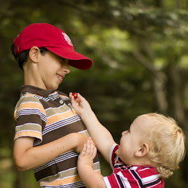 Sharing by Tig Tillinghast - Babies & Children Children Candids ( sharing, cherry tomato, cousins, toddlers )