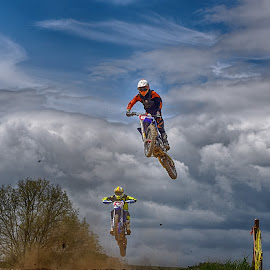 Flying High ! by Marco Bertamé - Sports & Fitness Motorsports ( clouds, speed, 33, number, yellow, race, noise, two, sky, red, motocross, blue, 6, dust, clumps, grey, duel )