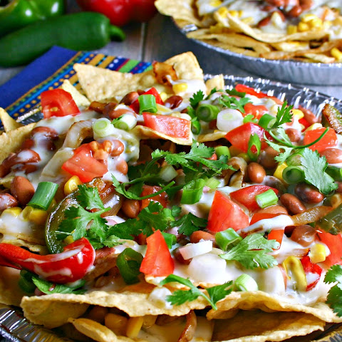 Supreme Veggie Nachos with Green Chilie Cheese Sauce