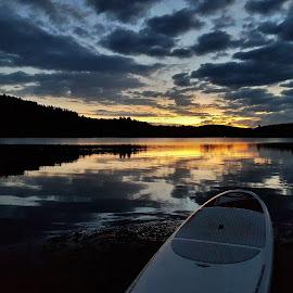 Sunrise SUP ride by Trevor Hanson - Instagram & Mobile Android ( reflection, serene, lake, sunrise, landscape )