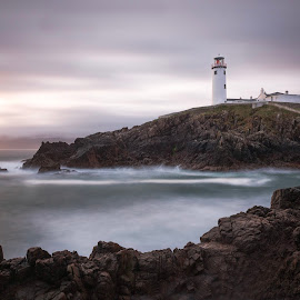 Fanad head lighthouse  by Matthew Gavin - Landscapes Sunsets & Sunrises ( lighthouse, sea, long exposure, sunrise, rocks )