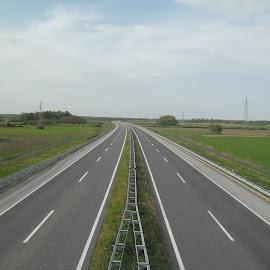 Lonely road by Alba Nix - Transportation Roads ( green, travel, road, landscape, fields )