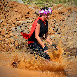 Mud Water Splash by Marco Bertamé - Sports & Fitness Other Sports ( water, red, splash, lady, the mud day, jump )