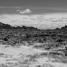 Badlands by John  Pemberton - Landscapes Deserts ( clouds, erosion, black and white, south dakota, badlands )
