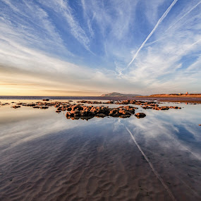 Looking North by Graham Kidd - Landscapes Beaches ( clouds, water, sand, sky, sea, reflections, beach, rocks )
