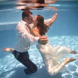 Free by Andrew Morgan - Wedding Bride & Groom ( love, water, kiss, ttd, wedding, movement, destinationwedding, happiness, trash the dress )