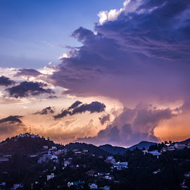 Drama In the Sky by Geetika Johnson - Landscapes Cloud Formations ( mountains, cold, purple, rainy, sunset )