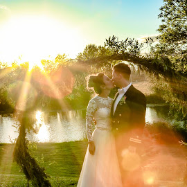 Sunset Burst Kiss by Debbie Slocum Lockwood - Wedding Bride & Groom