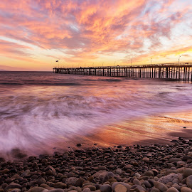 Return of the Clouds by Angel McNall - Landscapes Sunsets & Sunrises ( clouds, orange, rocky shoreline, sunset, california, ventura, pier, ocean, long exposure, pink )
