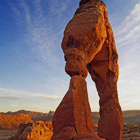 Delicate Arch at Sunset by Justin Giffin - Landscapes Caves & Formations ( moab, desert, arches national park, utah, sunset, red rock, delicate arch, landmark, travel, , color, colors, landscape, portrait, object, filter forge, Free, Freedom, Inspire, Inspiring, Inspirational, Emotion, Hope, golden hour, sunrise, #GARYFONGDRAMATICLIGHT, #WTFBOBDAVIS )
