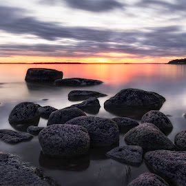 The Rocks by Jukka Pinonummi - Landscapes Sunsets & Sunrises ( clouds, water, canon, porvoo, 60d, finland, sea, ocean, rock, beach, baltic, eos, sky, sunset, light, longexposure, relax, tranquil, relaxing, tranquility )