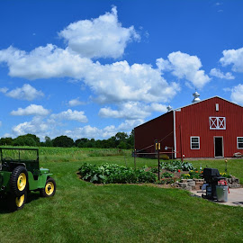 This is the Dodson family farm in Wisconsin, my grandfather owned it and my father grew up here. The farm was sold in 1940. My cousin bought the farm recently and has restored the barn. The jeep is a 1946 Willys with a frame off restoration, it was owned by my cousins father. by John Dodson - Buildings & Architecture Other Exteriors