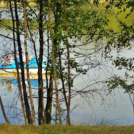 BEHIND THE TREES by Wojtylak Maria - City,  Street & Park  City Parks ( pedal boat, water, reflection, nature, trees, pond )