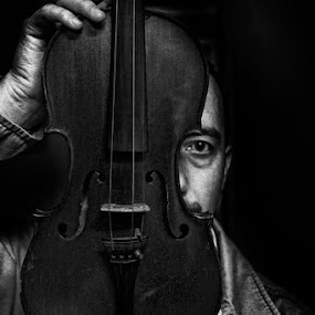 Dangerous by Erdem Photography - People Portraits of Men ( looking, suspicious, dangeour, violin, black white, man, eye )