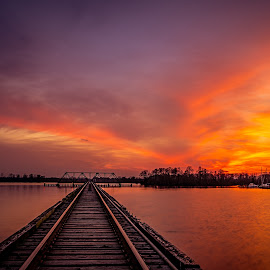 Fire in the Sky by Robert Mullen - Landscapes Sunsets & Sunrises ( clouds, train tracks, washington, train trestle, sunset, bridge, river )