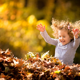 Fall Joy by Mike DeMicco - Babies & Children Child Portraits ( warm, play, children, little, leaf, leaves, cute, pretty, jump, child, playing, girl, sweet, autumn, fall, pile )