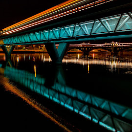 tram by night over water by Adrian Ramirez - Buildings & Architecture Bridges & Suspended Structures ( water, reflection, az, tempe, light trails, lake, cityscape )