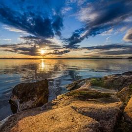 Sunset by Johan Lennartsson - Landscapes Waterscapes ( clouds, sky, warm, sunset, sweden., summer, sea, ocean, morga hage, uppsala, rocks, sun )