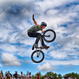 Can I really Fly ? by Marco Bertamé - Sports & Fitness Other Sports ( clouds, wheel, spectators, dow, helmet, stunt, bicycle, jump, two, flying, hands free, sky, blue, cloudy, air, grey, high )