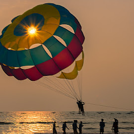 To Catch the Sun by Manabendra Dey - Sports & Fitness Watersports ( holiday, ssports, parasuite, water sport, goa, sun )