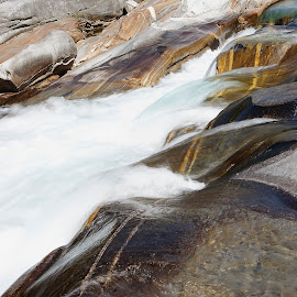 Lavertezzo, Ticino, Switzerland by Serguei Ouklonski - Nature Up Close Rock & Stone ( rock - object, long exposure, summer, rock, beautiful, stream - flowing water, waterfall, flowing water, land, day, no person, solid, motion, nature, switzerland, wet, beauty in nature, water, flowing, environment, ticino, outdoors, river, travel, scenics - nature, no people, lake, splash, non-urban scene, landscape )