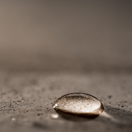 Waterdrop by Jacques Jacobsz - Abstract Water Drops & Splashes ( light-brown, surface, smooth, single, bright, drop, half, circle, through, highlight, clear, macro, clean, shadow, h2oround, wet, granite, water, texture, table, shape, back-light, see, background, up-close, reflect )
